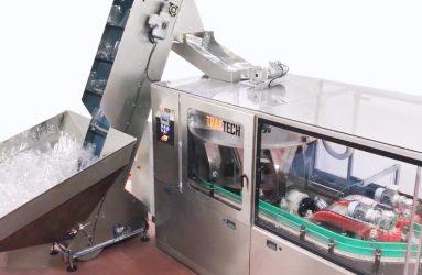 Embudo de alimentación en la máquina posicionadora y enjuagadora de envases | Traktech SL